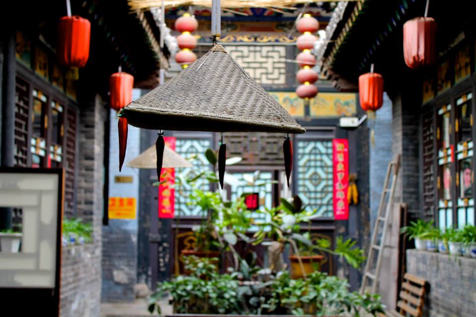 courtyard in Chinese house with lanterns and plants