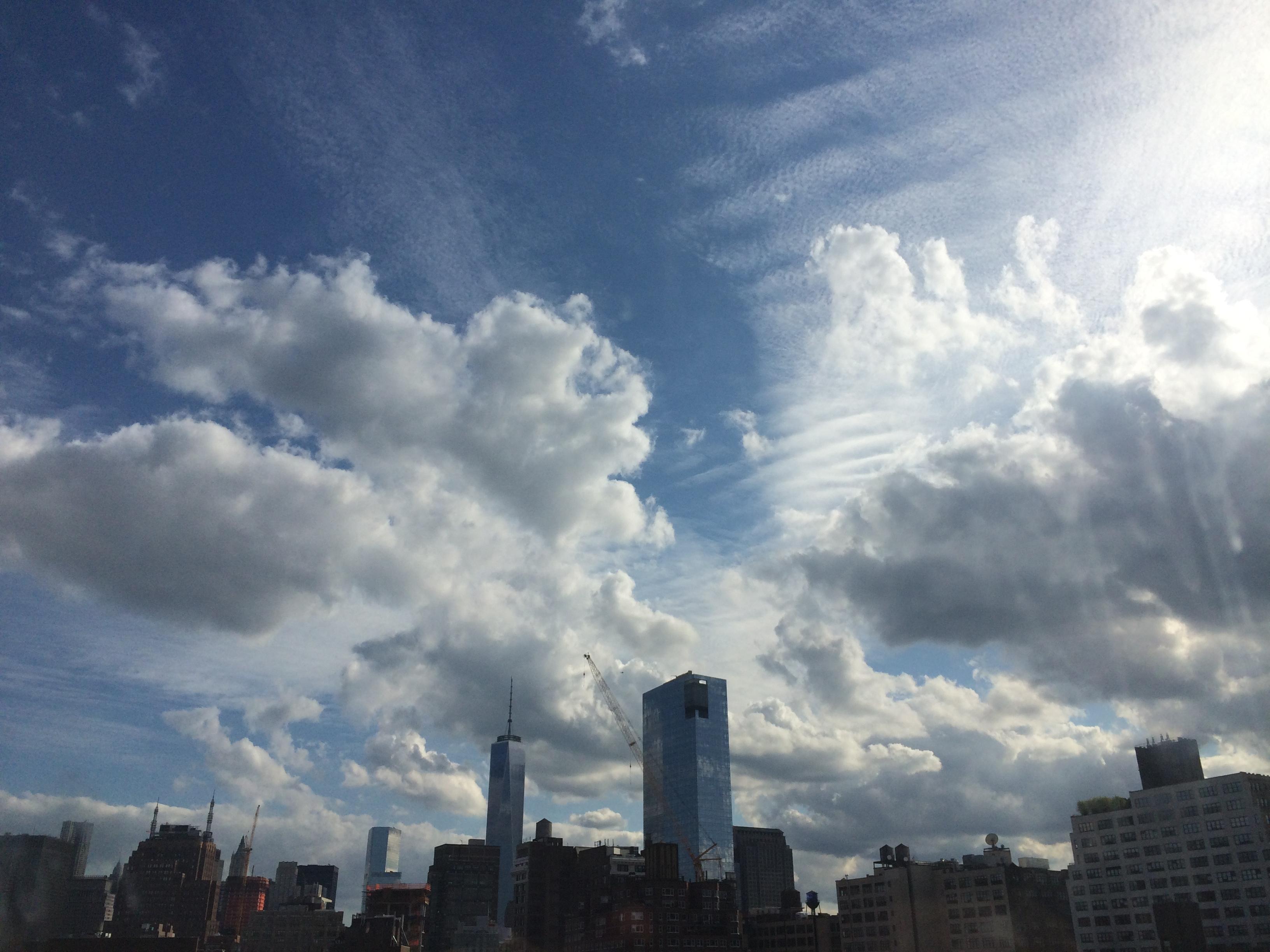 clouds above Manhattan skyline, including World Trade Center
