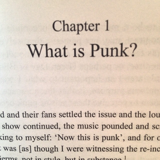 "book open to Chapter 1, entiled ""What is Punk?"""