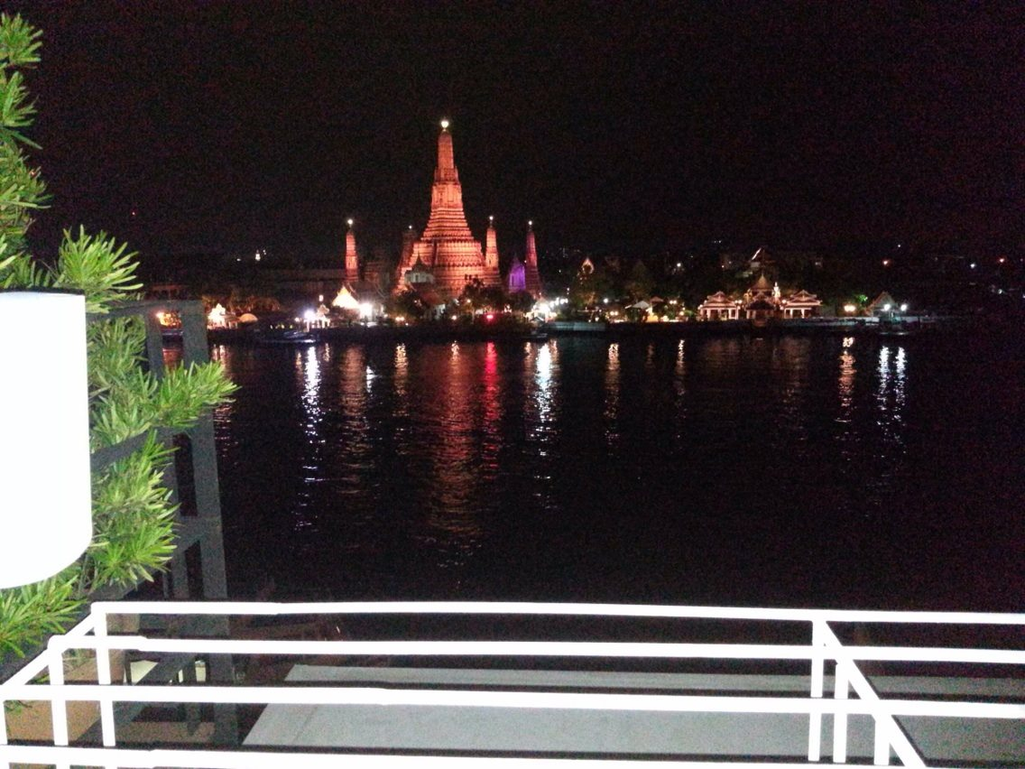 night view of Bangkok from boat on water