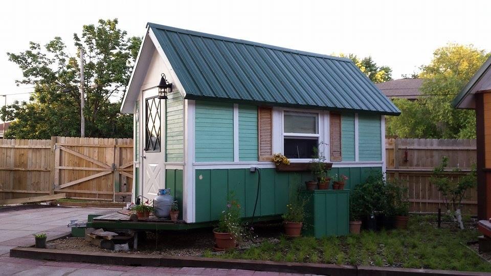 tiny green house on OM main street