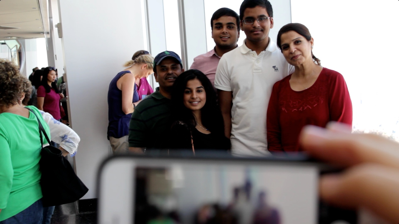 five people posing for picture