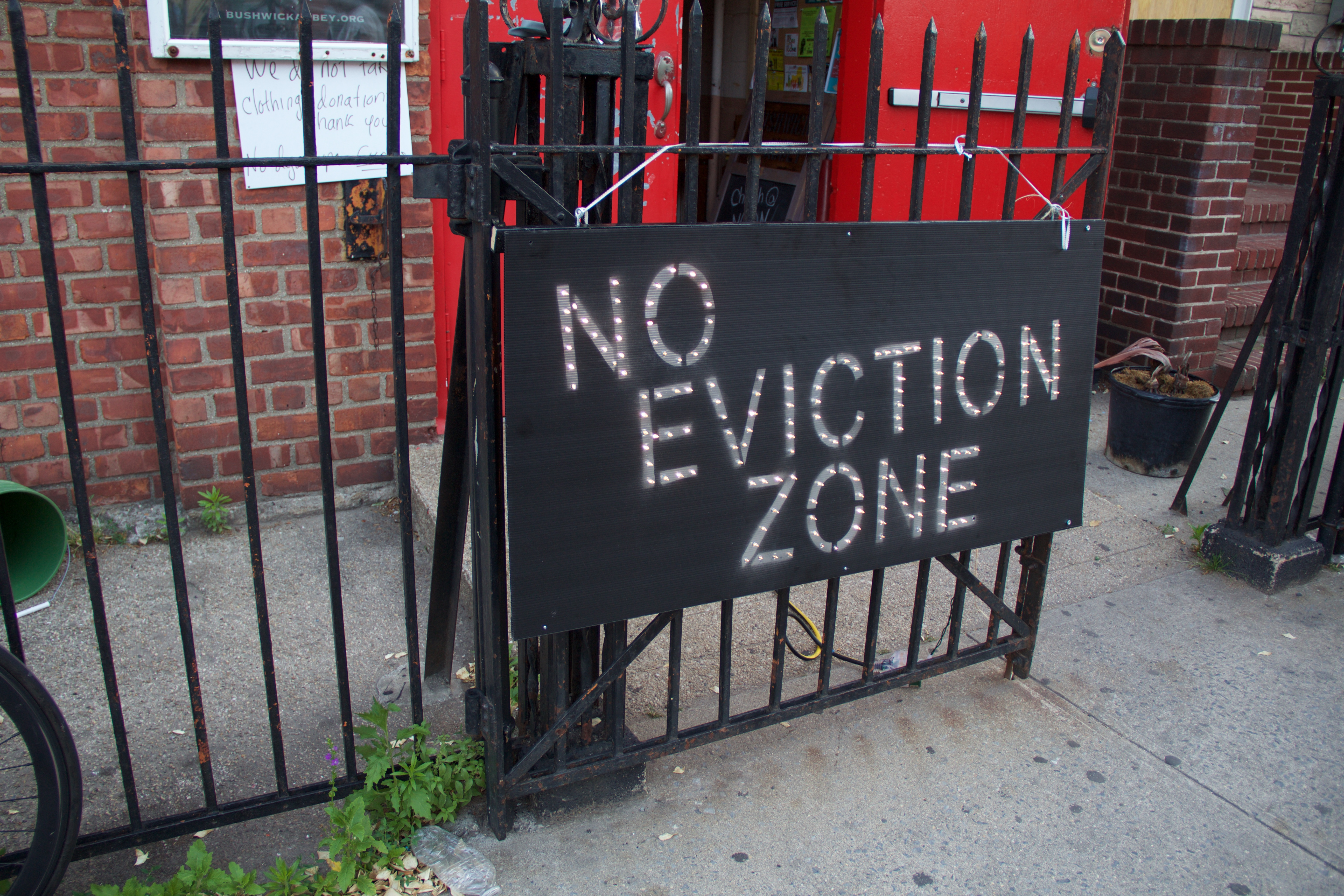 """sign that says """"No Eviction Zone"""""""
