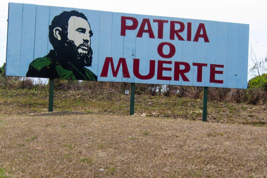 """sign with Castro that says """"Patria o Muerte"""""""