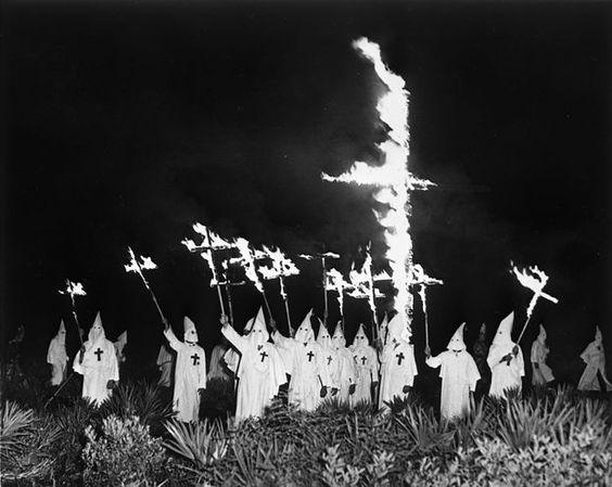 KKK burning crosses