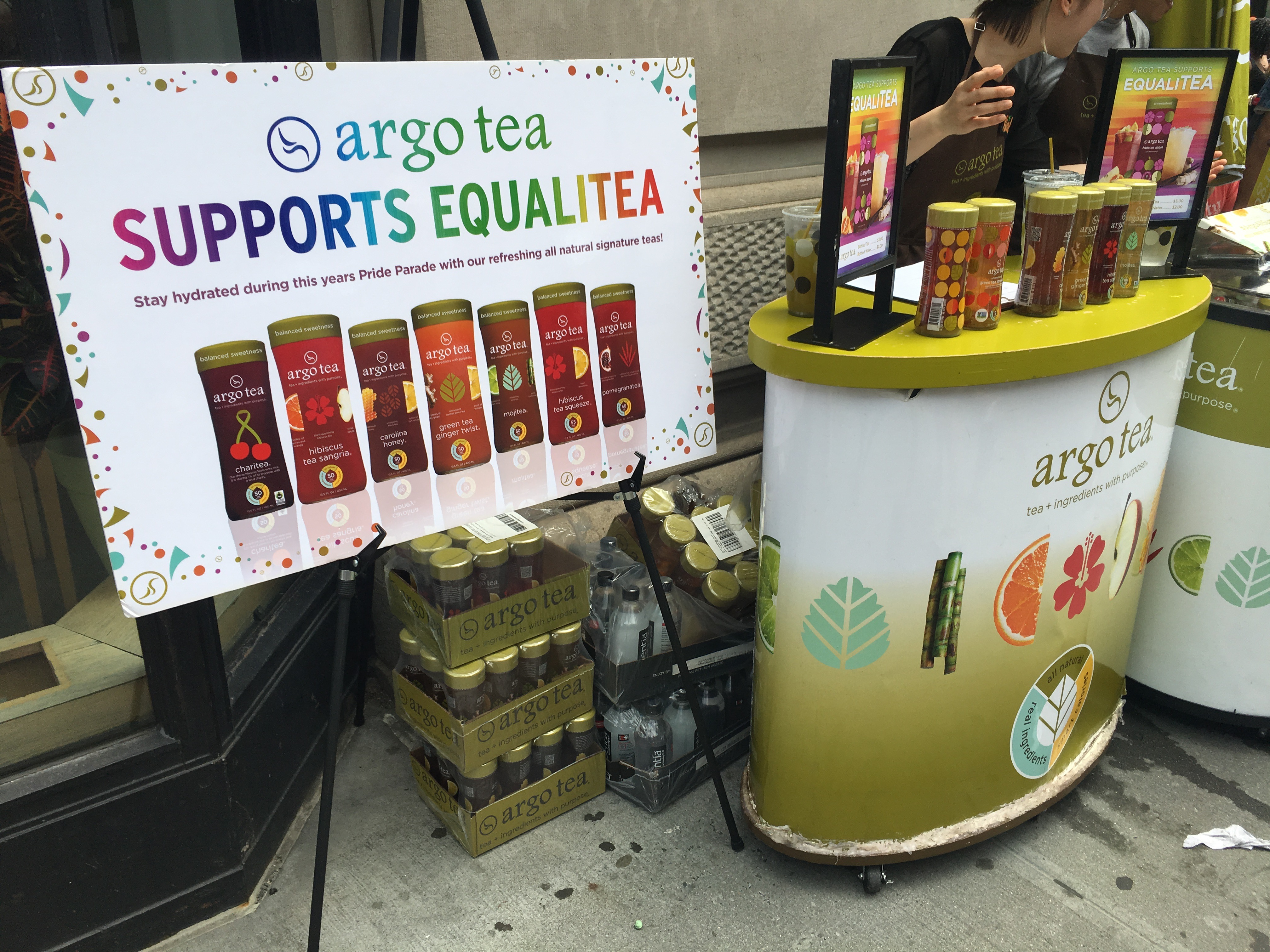 argo tea stand with tea and poster supporting pride
